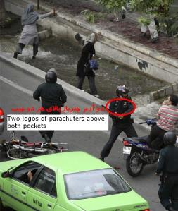Green uniform with Police written on the arms and two logos on the chest represent special forces of the IRGC (Sepah).